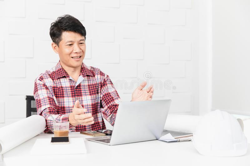 Asian architect at construction site office royalty free stock images