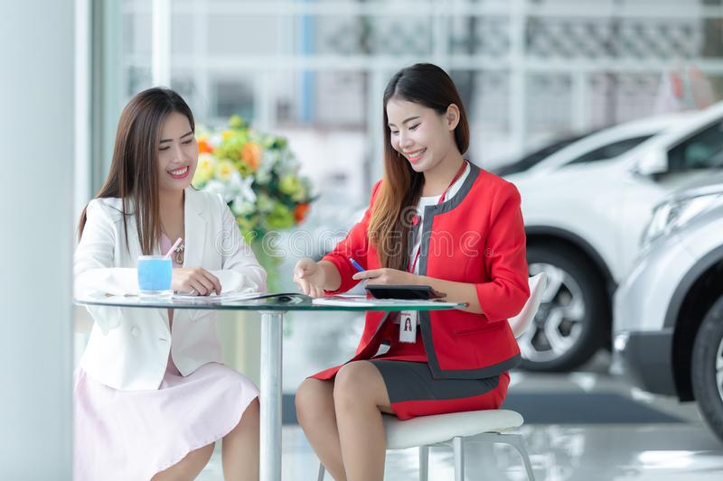 Asian auto business, car sale, technology and people concept - h stock photo