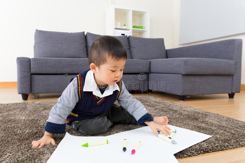 Asian baby boy drawing picture stock images