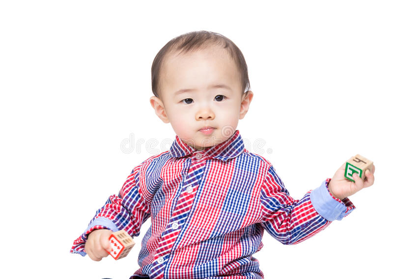 Asian baby boy holding toy block. Isolated on white royalty free stock image