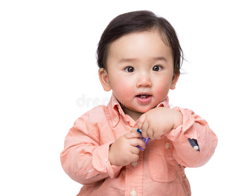 Asian baby boy holding toy block. Isolated on white stock photography