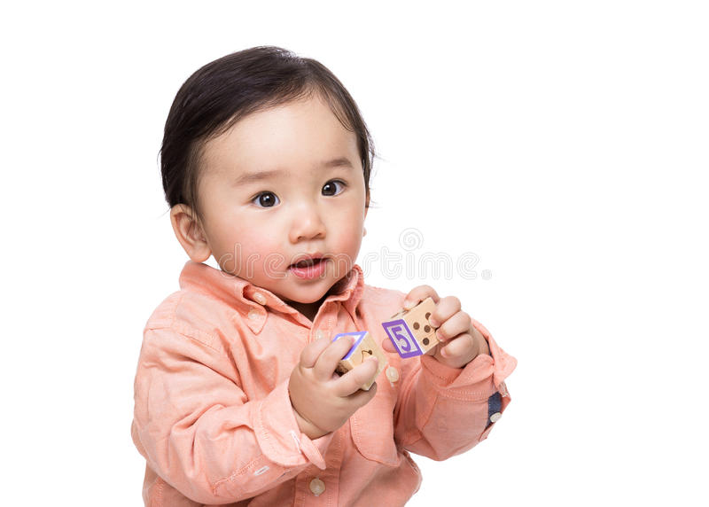 Asian baby boy holding wooden toy block. Isolated on white royalty free stock photo