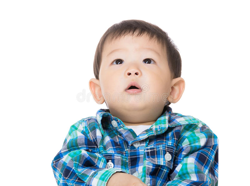 Asian baby boy looking up stock photo