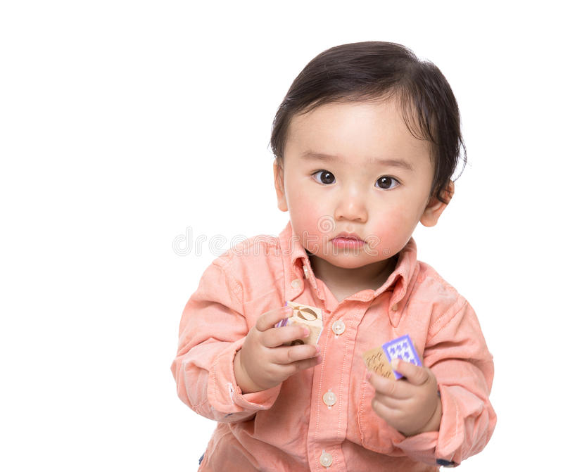 Asian baby boy play with toy block. Isolated on white royalty free stock image