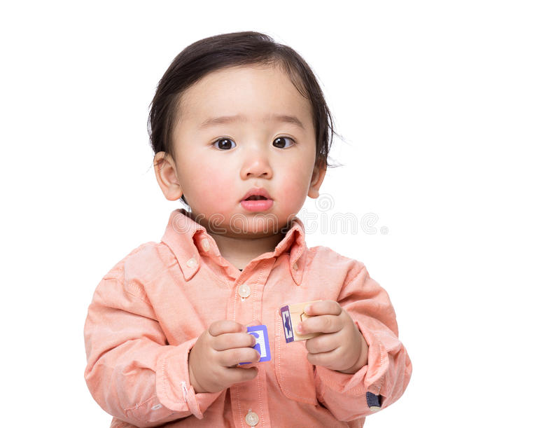 Asian baby boy play toy block. Isolated on white royalty free stock photography