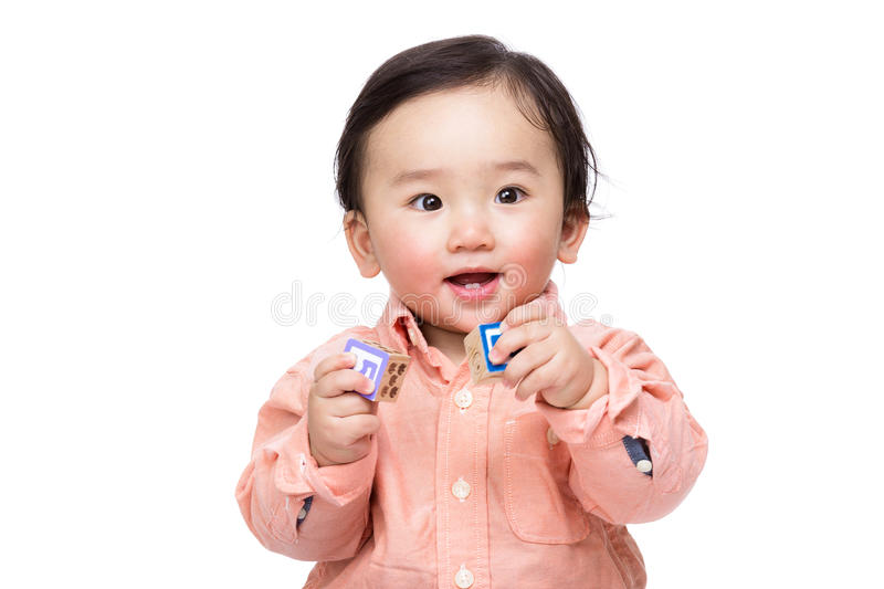 Asian baby boy play with toy block. Isolated on white royalty free stock images