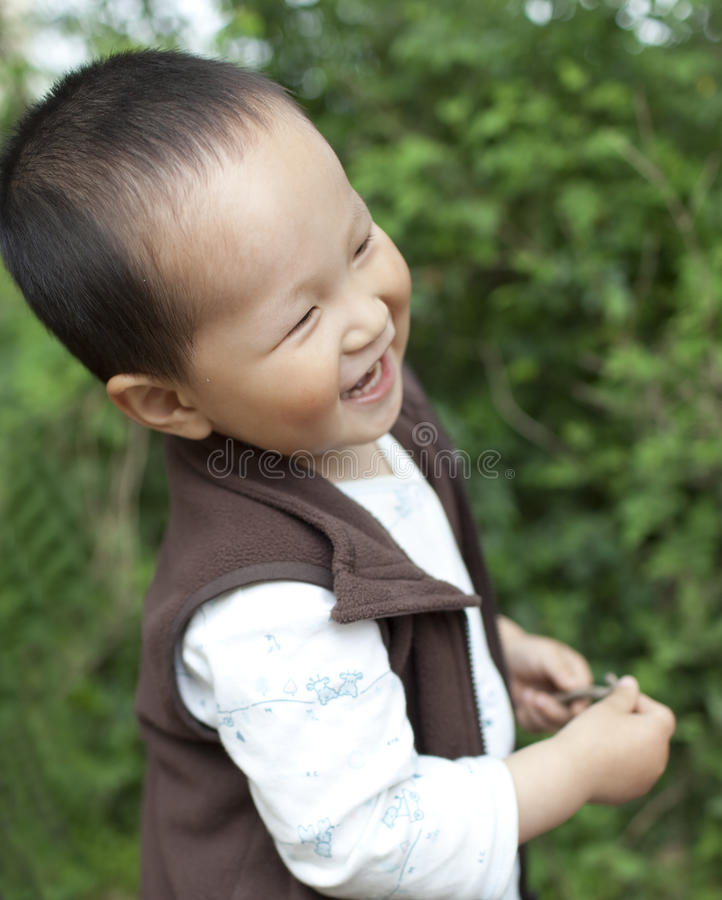 Asian baby boy playing in the garden royalty free stock photography
