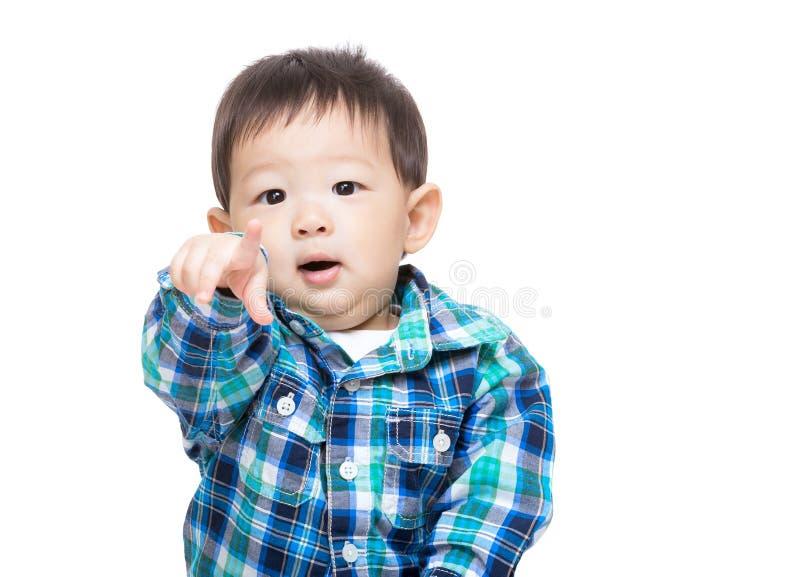 Asian baby boy pointing toward royalty free stock photo