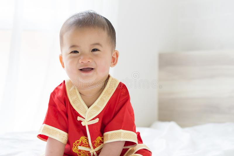 Asian baby boy smiling with traditional Chinese outfit. stock image