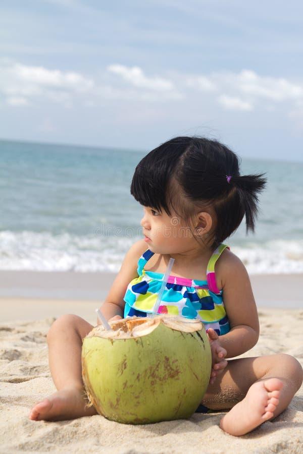 Asian Baby Girl On Beach Stock Photos