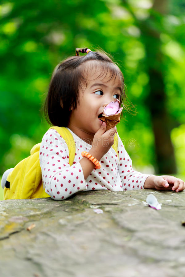 Asian baby girl eating icecream royalty free stock images