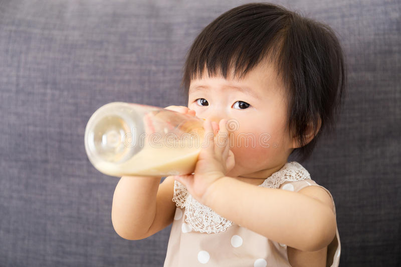Asian baby girl feed with milk bottle stock photos