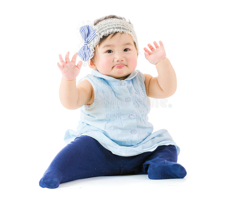 Asian baby girl hand up royalty free stock photography
