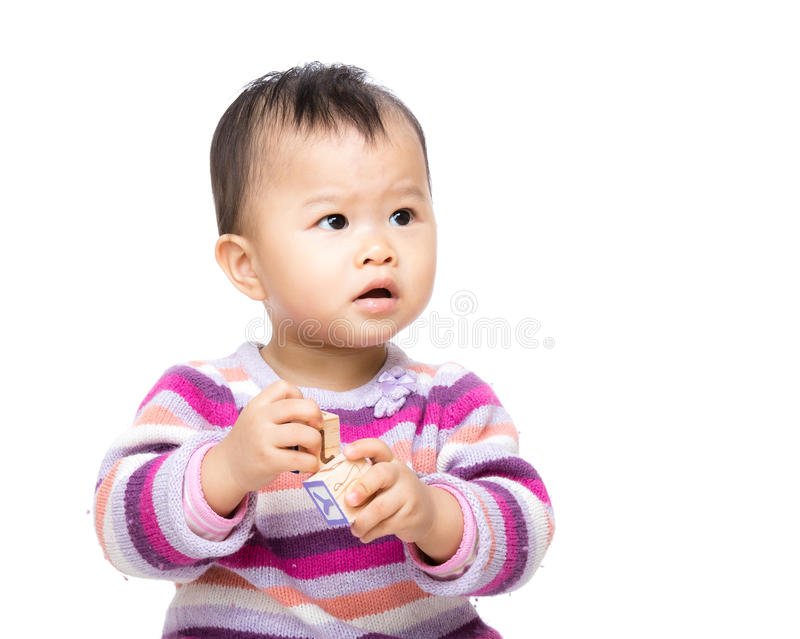 Asian baby girl play toy block and isolated. On white stock photo