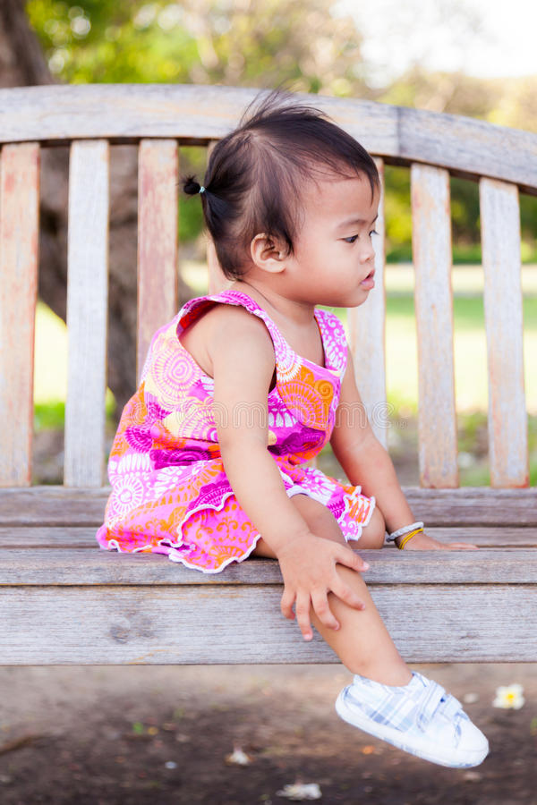 Download Asian Baby Girl Sitting On Bench Royalty Free Stock Photography - Image: 28016387