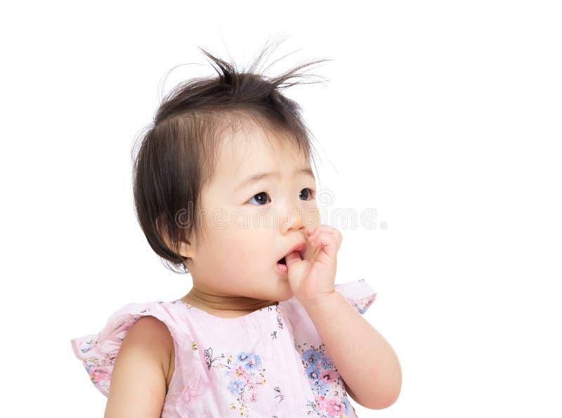Asian baby girl suck finger into mouth stock photos