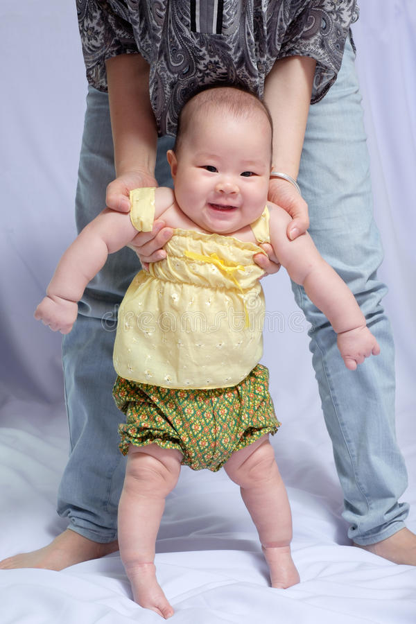 Asian baby girl in traditional thai dress stock photos