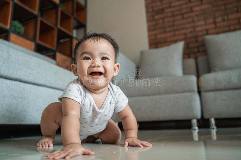 Asian baby learn to crawl. Baby learn to crawl on the floor at home royalty free stock photos