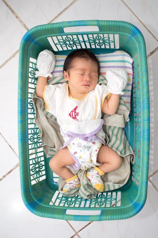 Asian Baby Sleep on Basket stock images