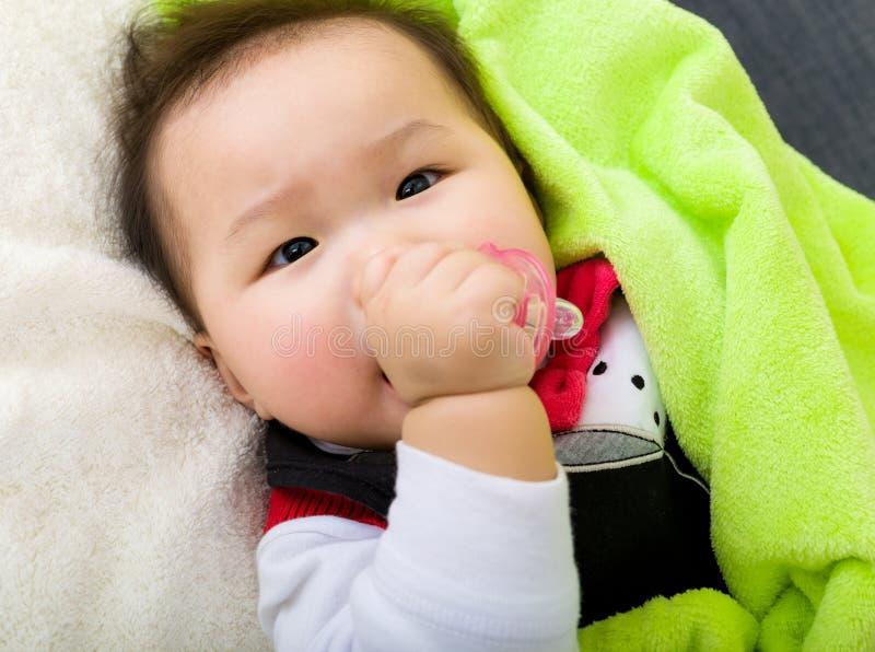 Asian baby sleeping on bed stock photo