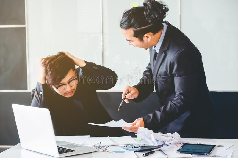 Asian Bad angry boss yelling at business man sad depressed employee reprimand from team leader missed deadline concept. Asian Bad angry boss yelling at business royalty free stock photography