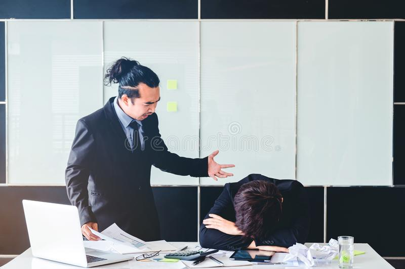Asian Bad angry boss yelling at business man sad depressed employee reprimand from team leader missed deadline concept. Asian Bad angry boss yelling at business royalty free stock photo