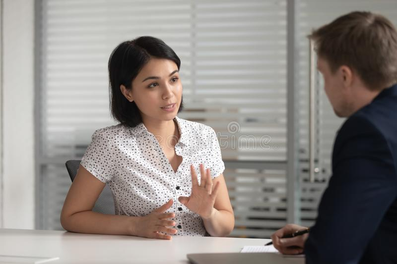 Asian bank manager job applicant talk to hr consult customer. Female asian bank manager insurer job applicant talk to male hr consult customer at interview stock photography