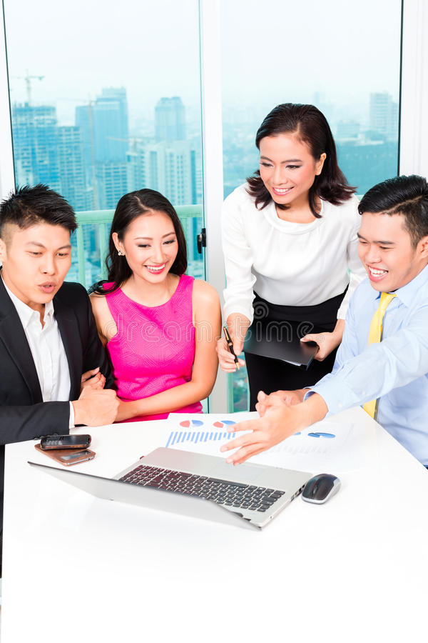 Asian banker team counseling couple in office. Asian banker team counseling client finance investment in bank office royalty free stock photography