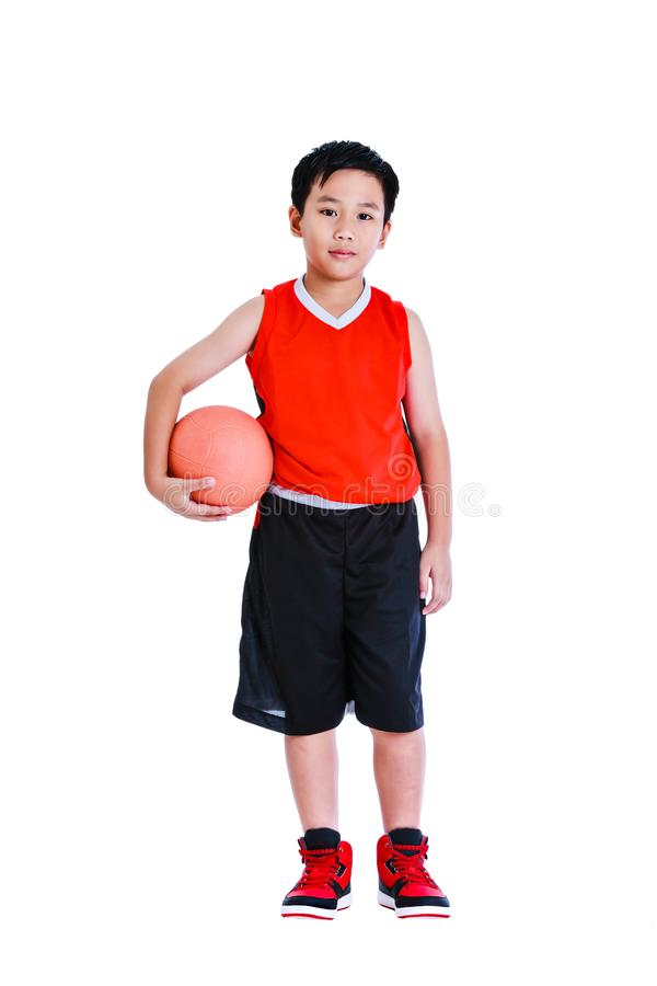 Asian basketball player posing with ball in his hand. Isolated o stock photos