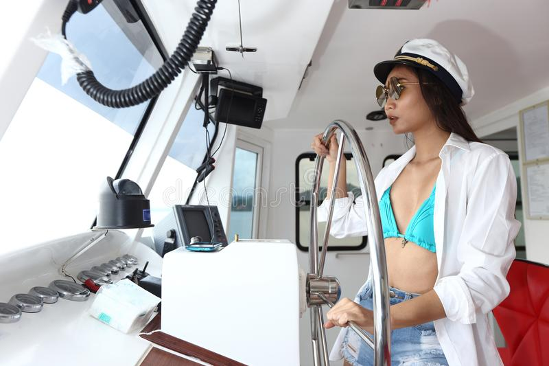 Captain Lady in Bikini and hat control Ship Steer in function Ro royalty free stock image