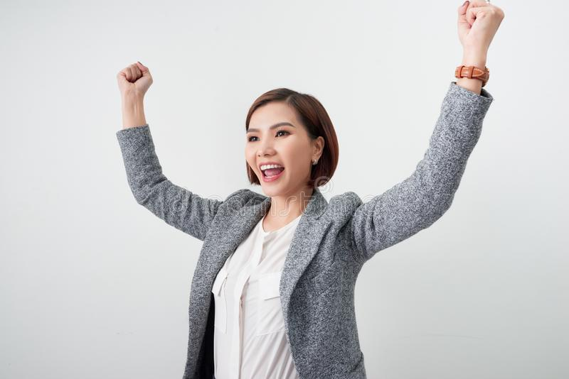 Asian beautiful girl feel happy. smiling woman show hand up successful sign action royalty free stock image