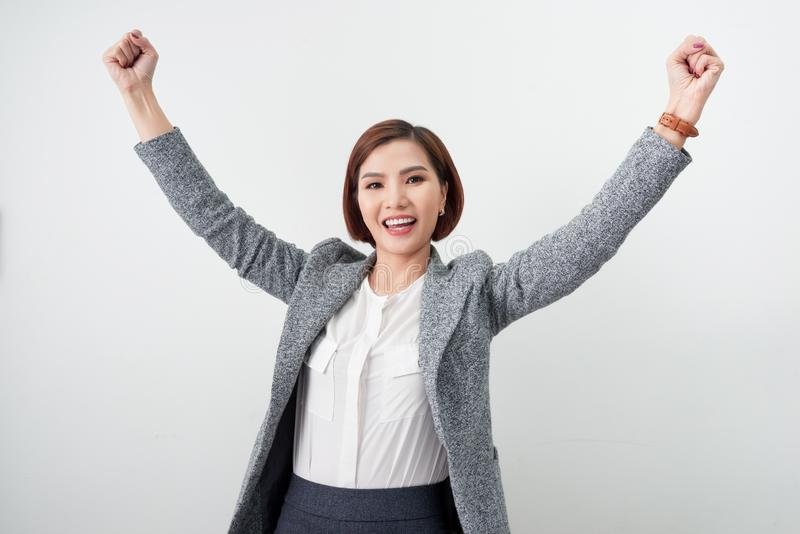 Asian beautiful girl feel happy. smiling woman show hand up successful sign action.  stock photo