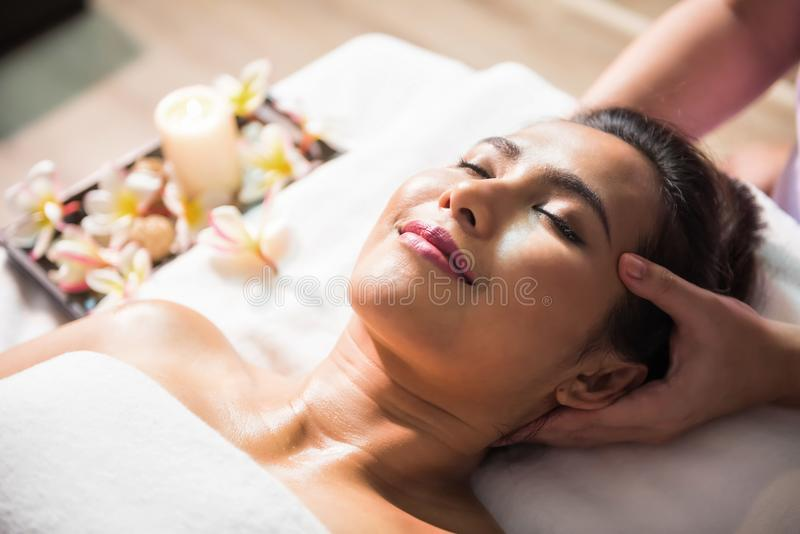 Thai oil massage therapy at head royalty free stock images