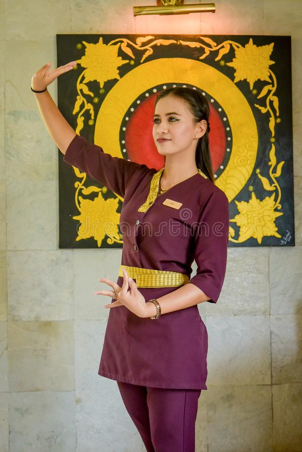 Asian beautiful waitress wearing uniform in the thai restaurant royalty free stock photography