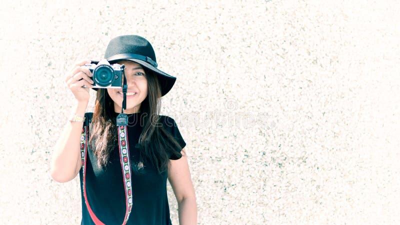 Asian beautiful woman with camera. Hipster fashion photographer, stock photo