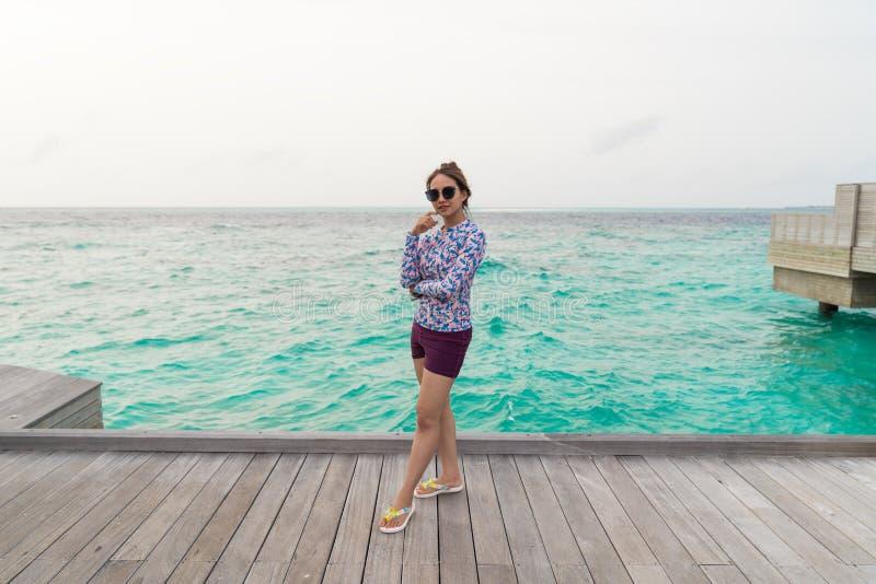 Asian beautiful woman enjoyful traveling sea background royalty free stock photo