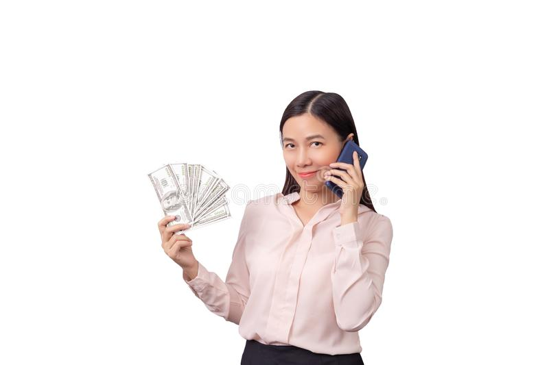 Asian beautiful woman holding banknote money in hand and mobile phone in another hand isolated on white background , clipping path royalty free stock photos