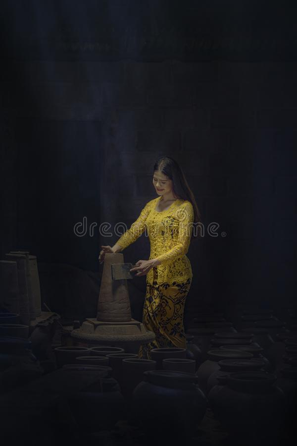 Asian beautiful woman are making pottery. royalty free stock images