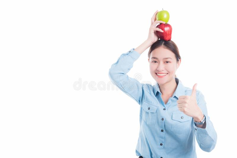 Woman put apples on head and showing thumb up royalty free stock image