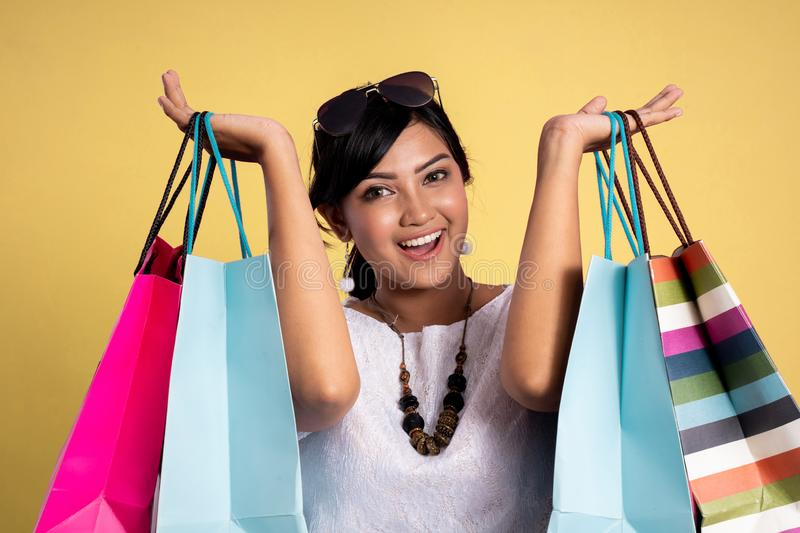 Asian beautiful woman with shopping bags royalty free stock photography
