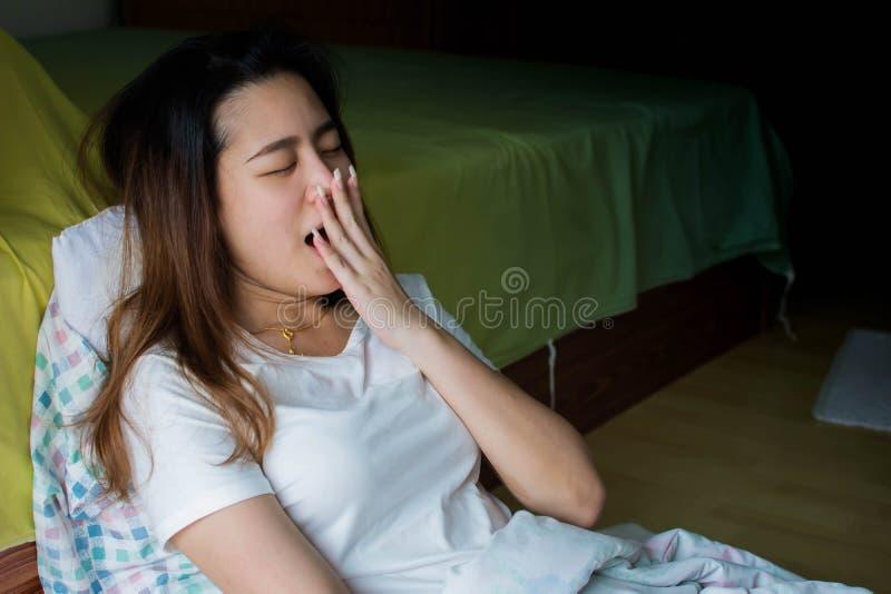 An asian beautiful woman is sleepy stock photos