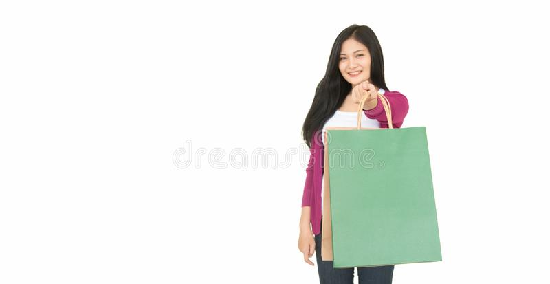 Asian beautiful woman smiles happily with shopping Beautiful woman carrying shopping bags on a white background royalty free stock images