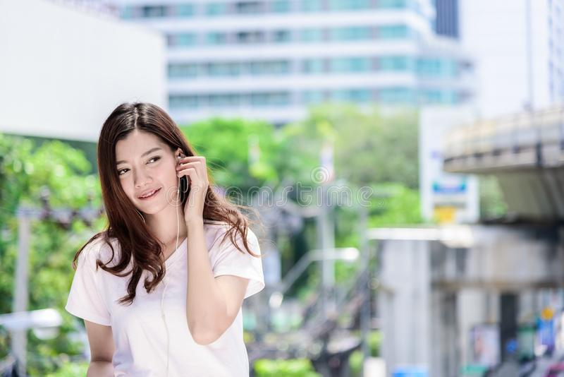 Asian beautiful woman tourist has music listening with headphone stock images