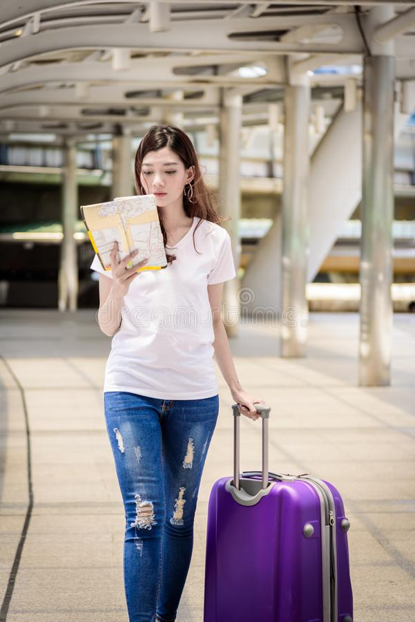 Asian beautiful woman tourist walking and travel with big purple royalty free stock image