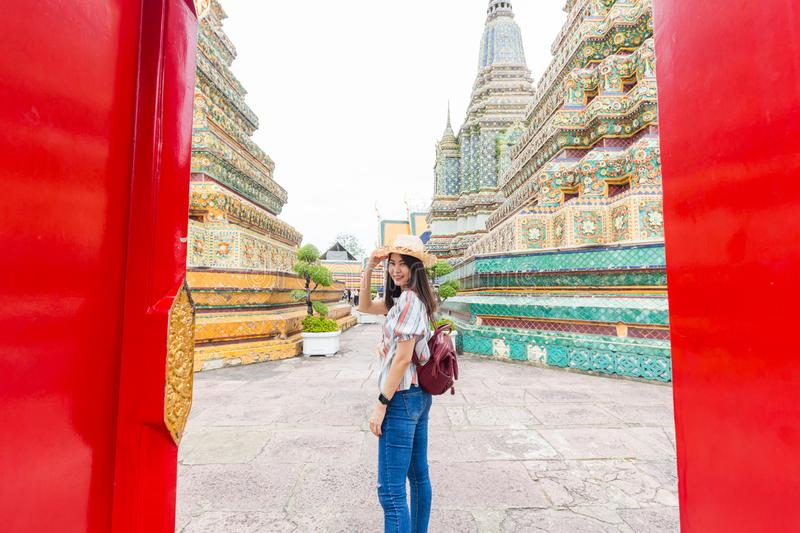 Asian beautiful women travel in buddha temple Wat Pho stock photography