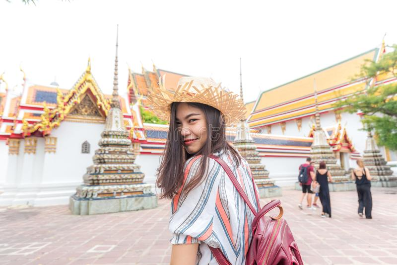 Asian beautiful women travel in buddha temple Wat Pho stock photo