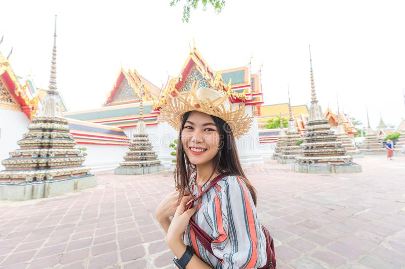 Asian beautiful women travel in buddha temple Wat Pho royalty free stock image