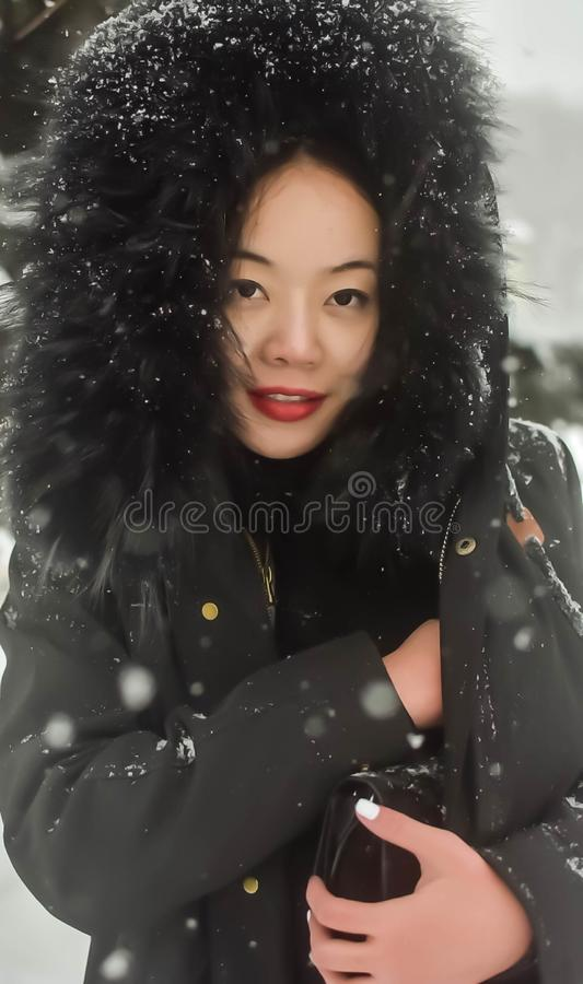 An asian beautiful woman wearing black coat and glasses stock photos