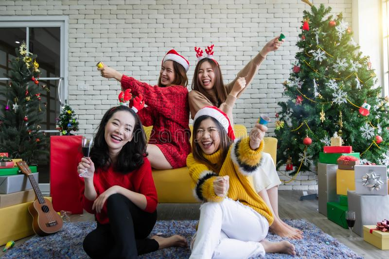 Women celebrating Christmas or New Year by using firecrackers stock image