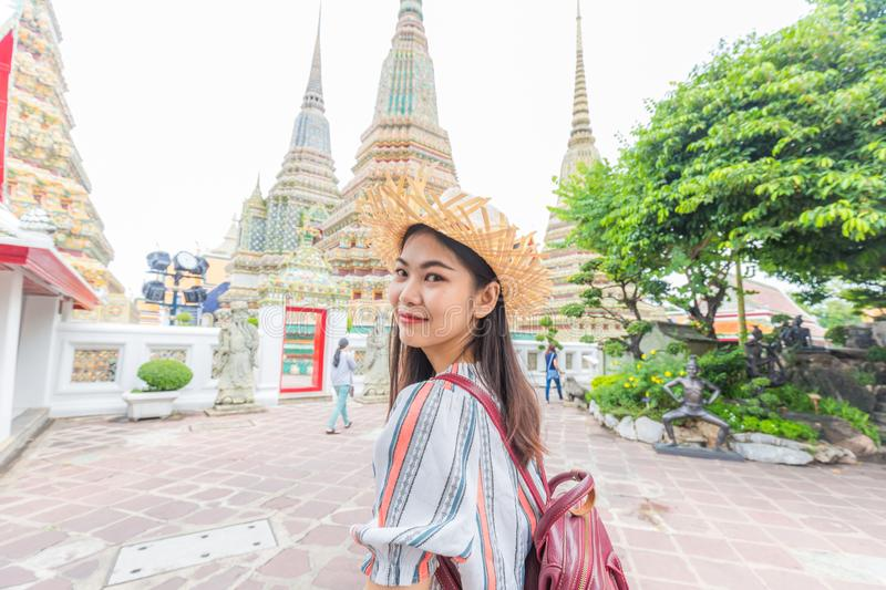 Asian beautiful women travel in buddha temple Wat Pho stock image